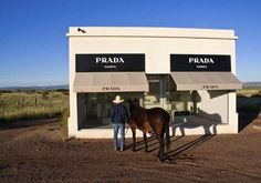 """Marfa. The coolest small town named after """"The Brothers Karamazov"""" in the world. Pop art exhibit """"Prada Marfa,"""" pictured above and located outside of town, is just one of the examples of culture that permeate the small-town-meets-art-town. Acclaimed minimalist artist Donald Judd moved to Marfa from NYC in 1971, and ever since Marfa has been a small but bustling home for modern art despite only housing around 2,000 permanent residents."""