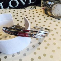 2 Michael Kors bracelet Silver tone Mother's day sale!! A 100% Authentic Michael Kors SILVER tone bracelet. Condition: New!!! Just worn to take photo! These two bracelets you can wear them together or alone. They're beautiful. I decided to put them on sale for whoever wants only bracelet. Retail price for the whole set for watch and bracelet is $375. Price FIRM.  But a lot cheaper if u buy the whole set! Cheaper at♏️ MICHAEL Michael Kors Jewelry Bracelets