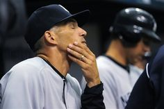 GAME 3: Sunday, April 8, 2012 - New York Yankees manager Joe Girardi reacts from the dugout during the ninth inning of a baseball game against the Tampa Bay Rays in St. Petersburg, Fla. The Rays won 3-0. (AP Photo/Brian Blanco)