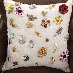 Another pinner says: My mothers beautiful pins displayed on a linen pillow!