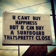 Money can't buy happiness but you can buy a surfboard...