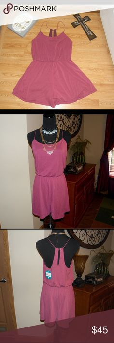 NWT Sz L Sugar plum romper by Naked zebra NWT Sz L Sugar plum romper by Naked zebra, beautiful and comfy romper with clinched waist dies stretch, thin straps, button closure in back, material and approximate flat laying measurements  in pics above,tag cut in half Naked Zebra Pants Jumpsuits & Rompers