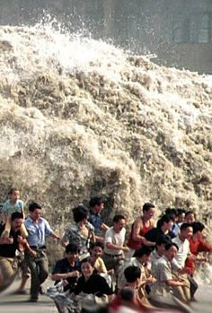 This is a picture of a TIDAL BORE taken in China in 2002. This IS NOT a December 26, 2004 tsunami picture. Still, I wonder how many of these people survived.
