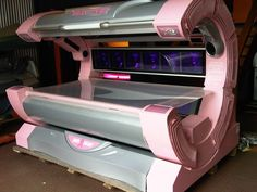 Pink tanning bed