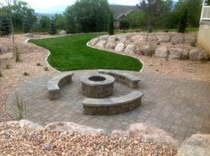 I love the fire pit that is in this landscape. I grew up with something similar to this in my backyard and my family would always be out there. Now that I have my own kids, I would love to have something similar. I'll have to look into installing something like this during the summer!
