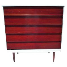 "Mid century modern red cherry dresser, restored and newly painted. Maker's mark reads ""Dixie."" Circa 1960s."