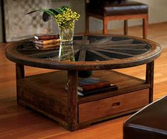Recycled wagon wheel table.  Just beautiful!