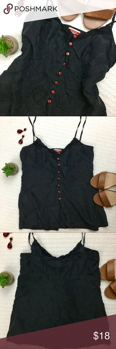 Guess Silk Camisole Guess 100% Silk camisole. It has beautiful lace detailing along the neckline and buttons down the middle. The buttons are clear with red floral detailing inside, so gorgeous! The color is a deep dark gray, almost black. The straps are adjustable for a custom fit 💕 Guess Tops Camisoles