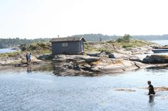 summerparadise Kragero Norway our kids swimming from islet to islet