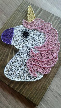 Add this vibrant unicorn string art piece to your little girls room Dark stained wood measures approximately 11 H x 9 L Other designs can be made to order to please message me Boards do not come with hangers on the back. If you would like that added please make your selection in the