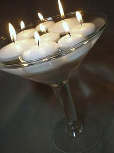 Martini glasses are my fave! Great selection on floating candles!! I would put food coloring in the glass and glitter to add some color and sparkle :)