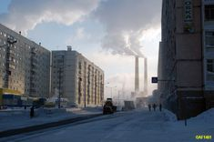 ...there's far north mining town of Norilsk.           Talnahskaya Street, Norilsk.  Siberia, Russia    ----------                             A city in the arctic dessert. A city without a single tree. A polar oasis.