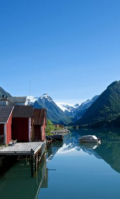 The Sognefjord extends from the coast, just north of Bergen, to the mighty mountains of the Jotunheimen National Park and the blue ice of the Jostedalsbreen National Park.