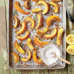 Parmesan-Rosemary Pumpkin Wedges with Lemon Cream -- pumpkin, oil, parmesan, lemon zest, breadcrumbs, rosemary, garlic clove, salt, pepper