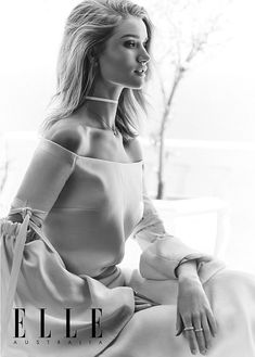 Ethereal: Rosie proves she is perfection in front of the camera, stunning in this off-shoulder gown