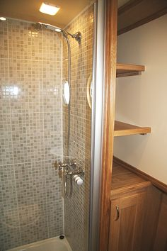 Great use of wasted space in the shower space