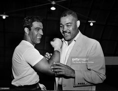Rocky Marciano and Joe Louis talk boxing where Marciano is training for his title defense against Archie Moore at Grossingers New York September 1 Joe Louis, Archie Moore, Star Trek Posters, Lebron James Basketball, Boxing History, Boxing Champions, Combat Sport, Sports Figures, World Of Sports