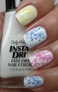 Two coats of Sally Hansen Whirlwind White, Stamped with Sally Hansen nail polishes using Red Angel plates RA104