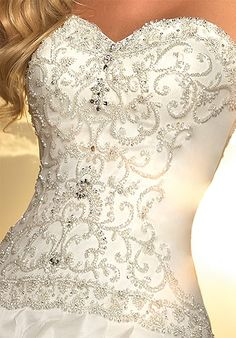 I don't like the thought of a white wedding dress...but this is beautiful! Maybe I could get this in red one day :)