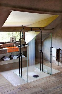 Love this bathroom! Free standing black shower with glass walls and a copper sink