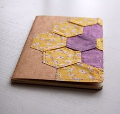 Vintage Hexagon notebook--I have some old quilt squares I could use this way.