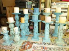 Old table legs upcycled into Candle pedestals
