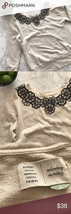 Anthro Saturday Sunday Floral Appliqué Sweatshirt Good condition. No defects. Cute and feminine twist on your basic sweatshirt. Floral appliqué detailing at neckline. Ruched detail at hip. Anthropologie Tops Sweatshirts & Hoodies