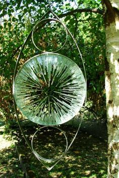 Stainless steel. stained glass Garden sculpture by artist Jane Bohane titled: 'Threescore'