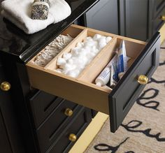 Partitioned Drawer, great for storing smaller items like cotton balls, toothpaste and more.