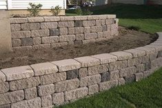 This simple tiered wall blends Standard and Cobble units in two colors for added interest. Product used: Cobble Standard