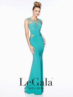 Le Gala - 116515 - Jewel neck prom dress, sleeveless jersey sheath, illusion jewel neck and side insets with heat-set stones, deep-notched bodice, beaded illusion keyhole back. Click to view more jewel neck prom dresses.Sizes: 0 - 16Colors: Black, Wine, Royal Blue, Magenta, Green