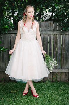 custom vintage-style tea length bridal dress  http://www.weddingchicks.com/2013/11/08/wizard-of-oz-wedding/