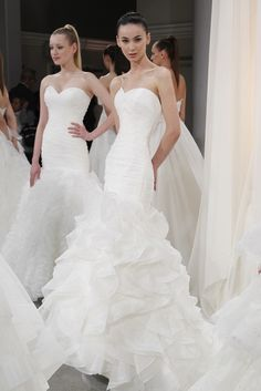 Dennis Basso for Kleinfeld Bridal Fall 2012 - Jay Ree was the lead stylist for this presentation! Don't you love a chic ponytail for a modern bride?