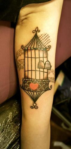 Pretty birdcage abstract tattoo.