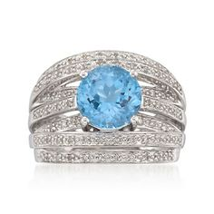 3.20 Carat Blue Topaz and .20 ct. t.w. Diamond Highway Ring in Sterling Silver