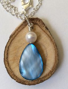 Polished Shell and Pearl Essential Oil Diffuser Necklace Made with Magnolia Wood by LowcountryEclectic $15.00 FREE SHIPPING--This one is perfect for someone who is in love with the ocean, the polished shell charm reminds one of the sparkling waves on the ocean and the pearl reminds one of the many treasures that you can find there.