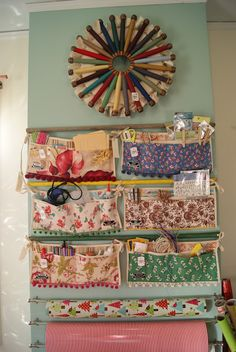 A lot of inspiration for a craft room, my favorite is these aprons used for storage, they have ball fringe on them!!! nest full of eggs: holiday ideas house