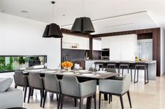"""Modern and contrasting kitchen and dinning in """"Expressing Views"""" by Urbane Projects, Perth."""