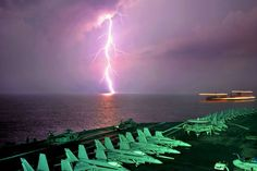 AMAZING MID-OCEAN LIGHTNING STRIKE JUST PAST AIRCRAFT CARRIER DECK - AWESOME NIGHT PHOTO!