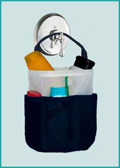 """Dorm Shower Caddy - White and Dark Navy Blue - by Saltwater Canvas by Saltwater Canvas. $16.97. Hang it right in the shower - fully waterproof.. Perfect for the college dorm, swimmers, travelers, gym members, etc.. Unlike canvas shower totes, this bag is mildew resistant and quick-drying.. Plenty of big pockets for all your shower accessories.. Fill it for a great gift!. """"Into the shower, dry in an hour!""""  Fill the portable Shower Bag with your shampoo, condition..."""