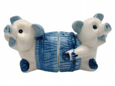 Pigs In Barrel w/ Delft Windmill Design . This charming and unique ceramic salt and pepper set will make for a great Dutch gift or accent to your home. - Approximate Dimensions (Length x Width x Heigh
