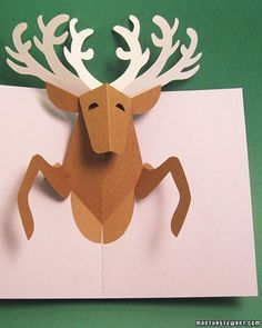 The Clever Reindeer Pop-Up Card | 49 Awesome DIY Holiday Cards http://www.marthastewart.com/266377/reindeer-pop-up-card?center=276974&gallery=275046&slide=266377