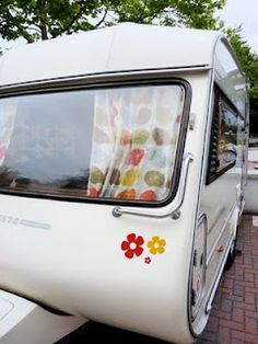 Not strictly my home but my caravan!  Renovated with Orla Kiely fabric curtains.