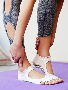 Need!  These barely there cotton yoga socks with cutouts provide a barefoot experience. With non-slip grip bottoms and half-toe design, they're perfect for all shoeless activities like: barre, Pilates, yoga, and dance. Features a super cute crochet ruffle top.