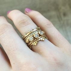 MATERIAL: 18k Yellow Gold   ORIGIN: USA  THE ROMANCE: An easy 18k yellow gold band from Ananda Khalsa gets a dose of sparkle crowned with twelve white diamonds set in 18k yellow gold.   SIZE: