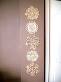 Make a wall hanging from doilies.  This tutorial uses sugar for stiffening, which I would not use