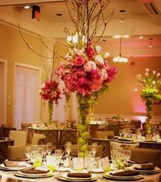 wedding centerpieces flowers: pine cones instead of apples, all white flowers and glittery silver branches