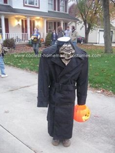 Homemade Headless Man Costume: My son wanted to be the headless horseman for Halloween last year so... where do I start? A trip to Goodwill yielded a trenchcoat, a scarf, and a black