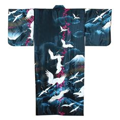This Kimono is adorned with cranes flying in the sky above Mt Fuji on a beautiful black polyester background with blue clouds. Made in Japan, this traditional Japanese Kimono has butterfly styled sleeves and a matching belt.