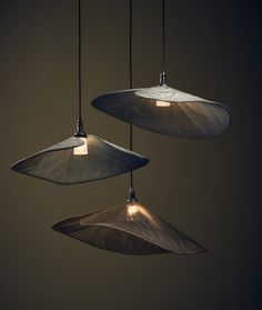 Handmade from woven aluminium fabrics, the Water Lily lamp floats overhead, an organic form allowing the metal textile to express itself beautifully. Exquisite on their own or hung in a group.